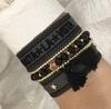 DARK Metallperlenarmband mit Quaste Black